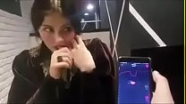 cute girl with remote vibrator in public صورة