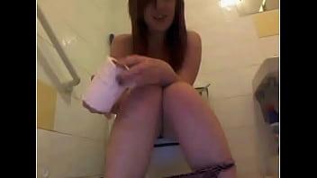 slut cam whore brings camera to pee toilet