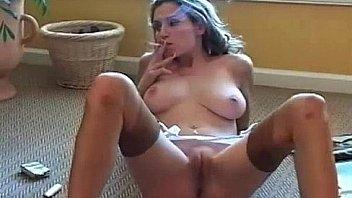 Sexy brunette MILF Jamie Lynn smokes