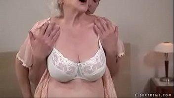 Busty grandma sucking cock