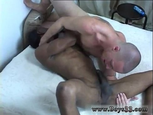 Two men fuck boy