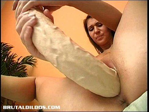 Brunette melinda stuffing her pussy with a brutal dildo 3