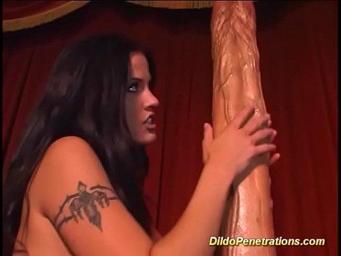 Dildo deep inside her
