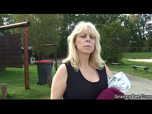 Granny sucks cock in public