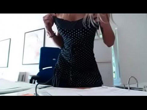 Milf masturbating at work