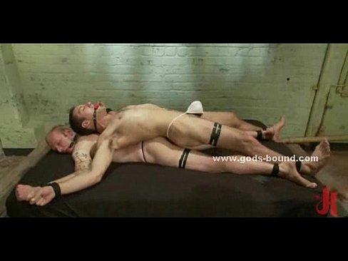 Gay slaves tied in bondage group sex