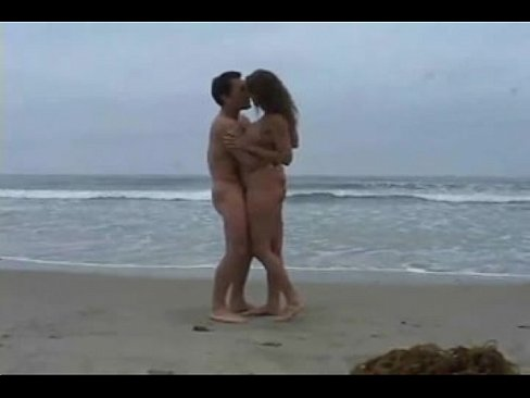 Real couple having sex on beach
